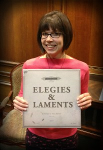 Jennifer Mercer, who designed the Elegies & Laments album (as well as both of Ernest Hilbert's books), poses with the finished product.