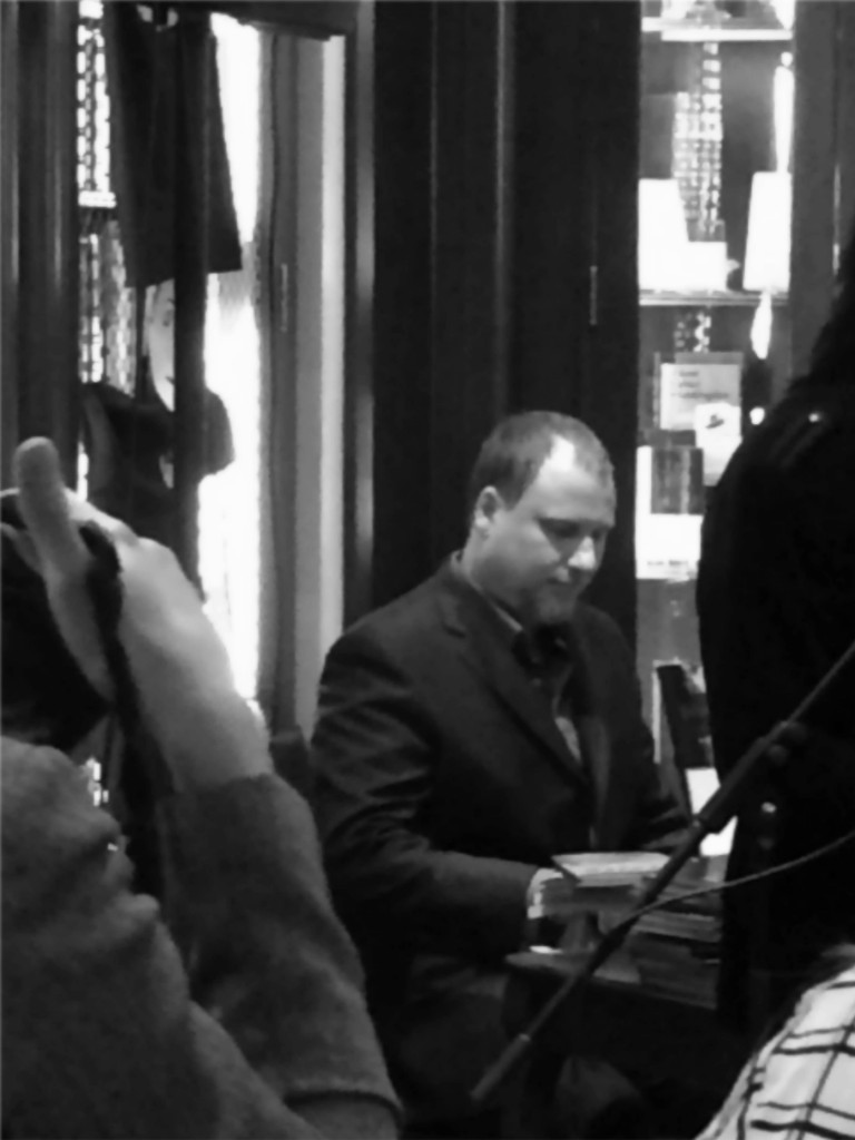 Hilbert signs copies of Caligulan at the New York City launch.